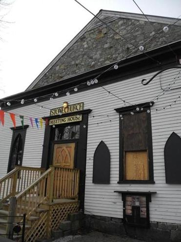 The Stone Church is known for its busy, eclectic menu of musical offerings. It also serves burgers, tacos, and local craft brews.